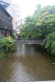 The Shirakawa river and the bridge to the entrance of Shiraume