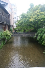 The Shirakawa river and the bridge to the entrance of Shiraume