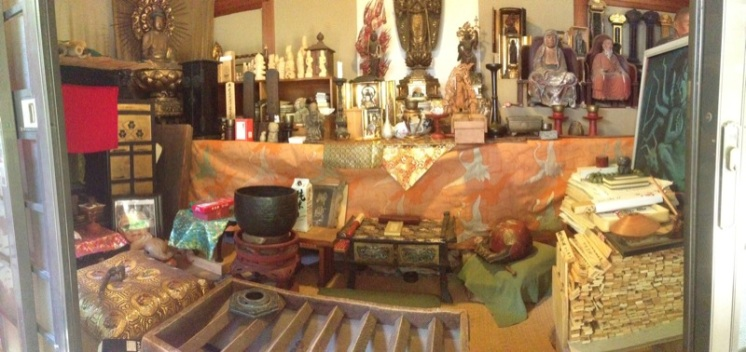 Toward the back of the open yard was a small shrine. Inside lived a whole collection of sacred objects.