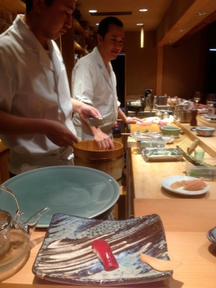 Shimazaki Daisuke, the restaurant owner, forming rice. Look at the tuna sashimi. It looks like sugar candy.